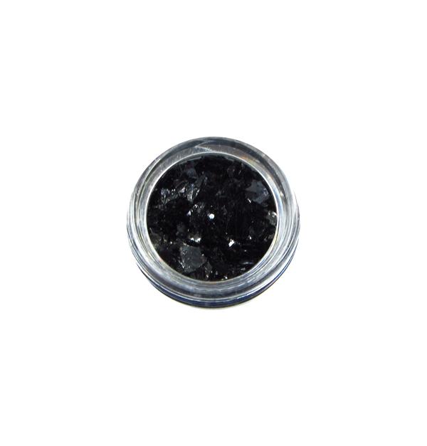 Βαζάκι με μαύρες νιφάδες ονυχοπλαστικής